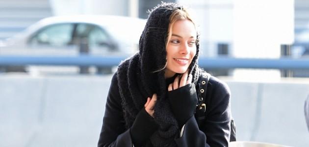 GALERIA: Margot embarcando no aeroporto JFK e desembarcando no LAX